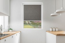 Roller blind in PVC cassette with a guide melange kora 739