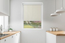 Blackout roller blind in PVC cassette with a guide krem 052