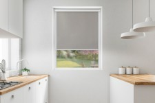 Blackout roller blind in PVC cassette with a guide popiel 054