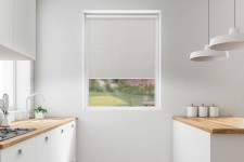 Blackout roller blind in PVC cassette with a guide topola 063