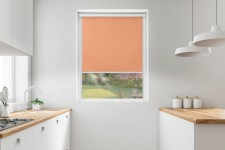 Blackout roller blind in PVC cassette with a guide oranż 060
